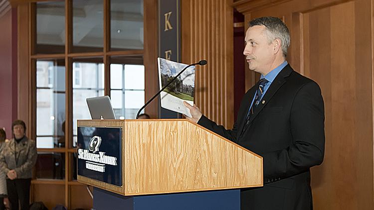 Kevin Wamsley at podium