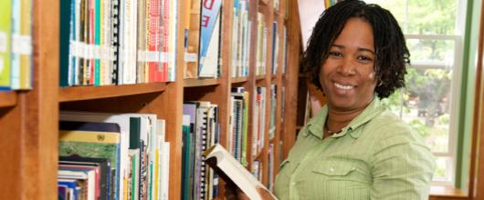 Student in the library at the Coady International Institute